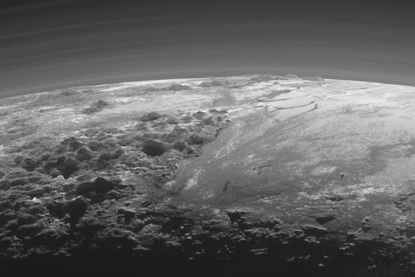 Majestic Mountains and Frozen Plains on Pluto