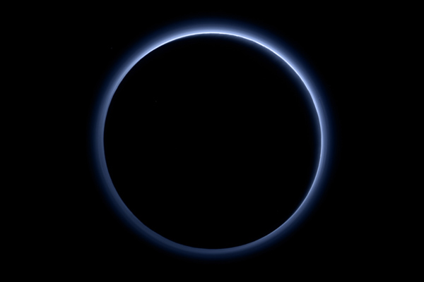 Pluto's atmosphere backlit by the Sun